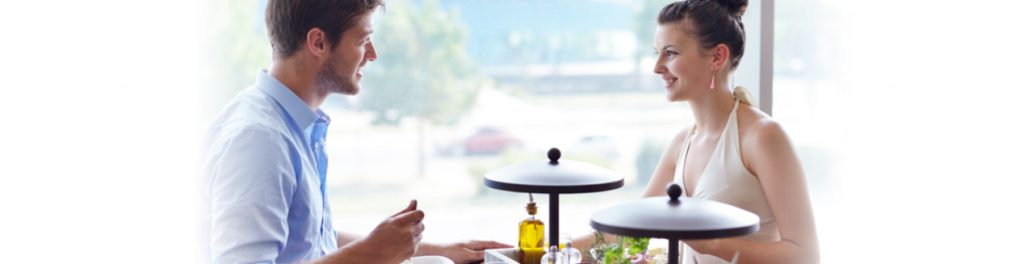 A man and a woman having a meal at a restaurant
